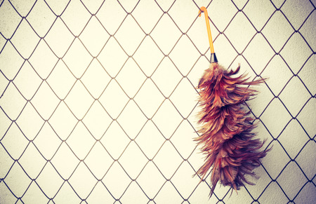 duster: duster on metal net background