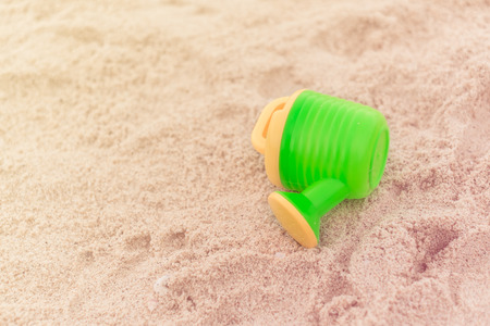 watering pot: watering pot on white sand