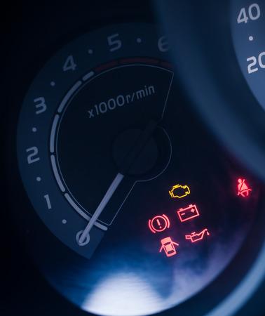 rev: closeup car dashboard and speedometer