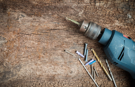 drill floor: drill tool on dirty wood background Stock Photo