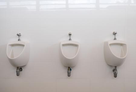 modern bathroom: Clean white urinal in men toilet