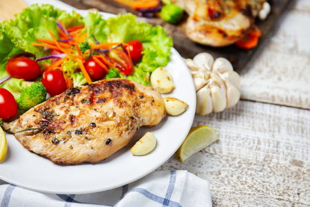 breast chicken salad serve with fresh vegetables on white dish