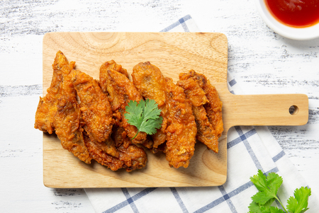 Fried chicken wings on wooden board. breaded crispy chicken serve with  ketchup