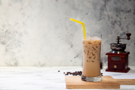 fresh ice coffee cup on the white wooden board