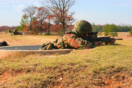 Soldiers firing SA80 rifles on a range photo