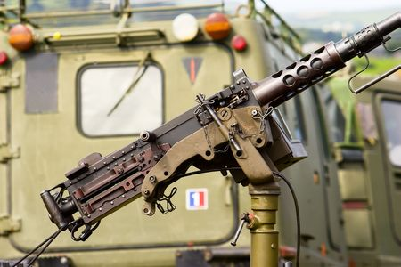 A machine gun mounting with a Viking armoured vehicle in the background. Banque d'images