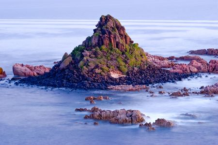 The Pyramid Rock, Philip Island, Australia with misty sea effect 스톡 콘텐츠