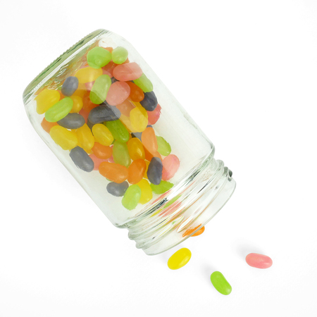 Jellybean in Glass bottles on white background