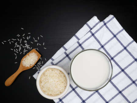 Rice milk on the black wooden background.