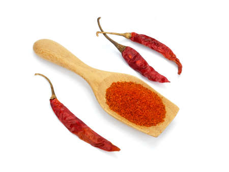 Chili powder and dried chilli in spoon on white background, cayenne pepper. Imagens