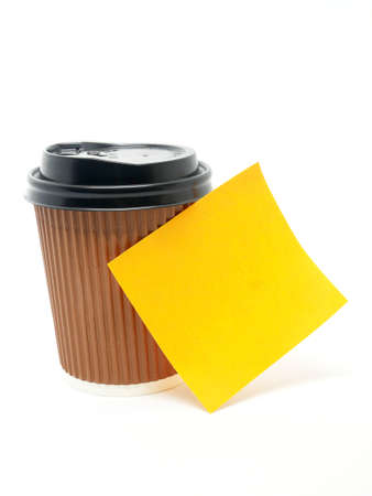 Paper note on coffee cup isolated white background