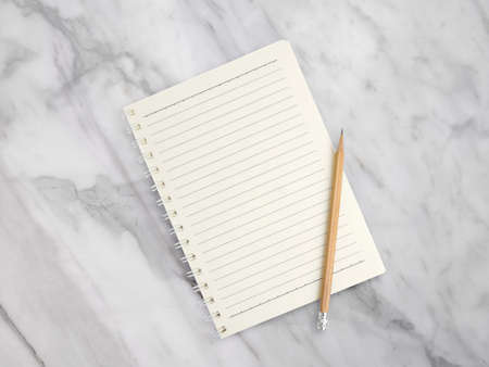 Notebook with pencil on marble texture background
