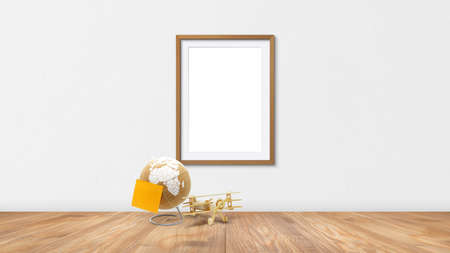 Blank frames mockup on wall with wooden plane and world