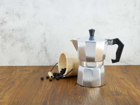 Coffee maker moka pot on wooden table.