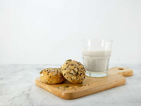 Whole grain bread with milk on texture background. Standard-Bild
