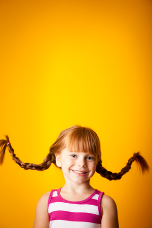 Happy Little Girl with Pigtails, Room for Text Above