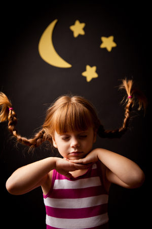 Whimsy Little Girl Dreaming in the Night Stock Photo