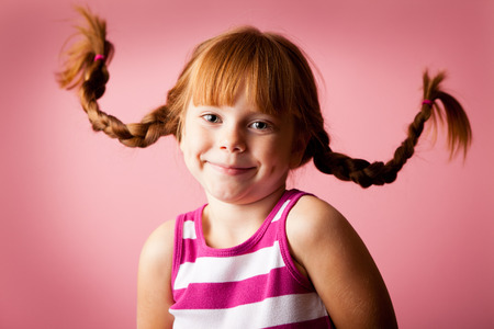 Little Girl with Floating Pigtails on Pink