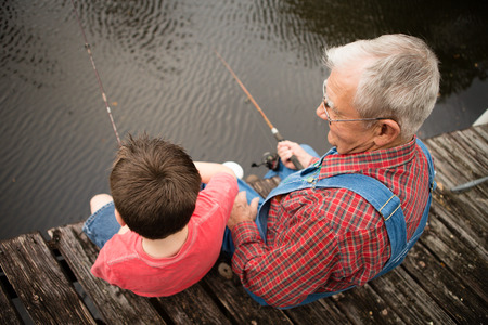 Great Grandfather and Grandson Fishing Together on Dock Standard-Bild