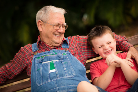 Great Grandfather and Grandson Laughing Together