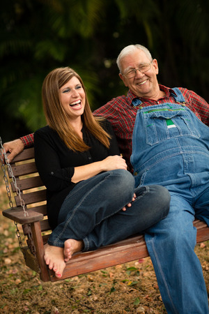 Grandfather and Granddaughter Laughing Together Standard-Bild