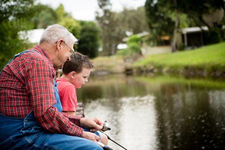 Senior Man Fishing with Great Grandson