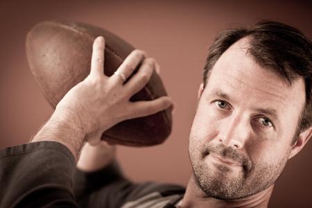 Quarterback Holding a Vintage Football Stock fotó