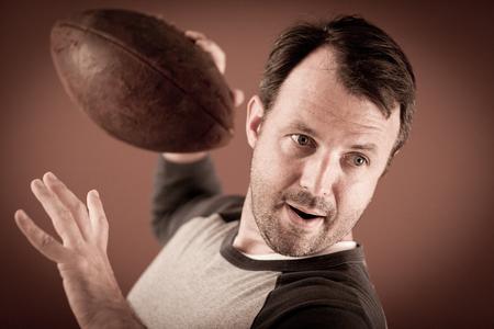Quarterback Ready to Throw a Football Stock fotó