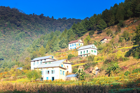 nepali: Traditional style beautiful houses of Nepali village near the forest in Chitlang,Nepal.