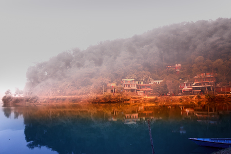 phewa: A beautiful village at the edge of phewa lake with morning sun lights.