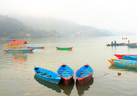 phewa: View of Phewa lake with colourful boats together in Pokhara,Nepal.