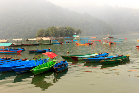 phewa: View of Phewa lake with colourful boats on the water in Pokhara,Nepal. Stock Photo