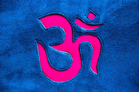 sacred symbol: OmAum symbol on a different background or texture. Stock Photo