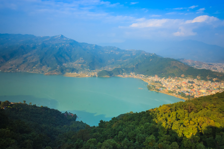 phewa: The beautiful city of Pokhara Nepal with phewa lake seen from the top of World Peace Stupa. Stock Photo