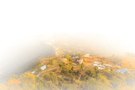 nepali: Nepali Village seen from the Sarangkot on a foggy day.