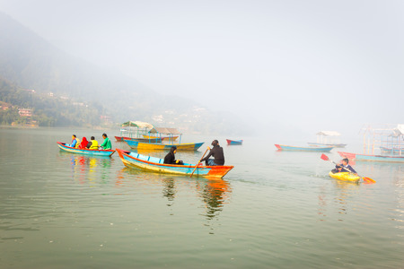phewa: View of Phewa lake with colourful boats and people in Pokhara,Nepal. Editorial