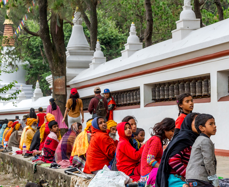 birthday religious: Kathmandu,Nepal - May 21,2016 : Poor Nepali people are begging in Swayambhunath Stupa on Buddha Jayanti or Buddhas Birthday.