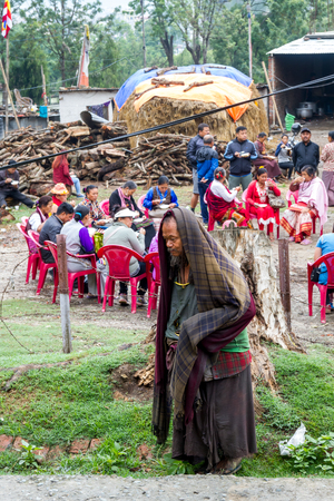 nepali: Kathmandu,Nepal - May 21,2016 : A poor Nepali Man is around the party venue with hoping to get something to eat.