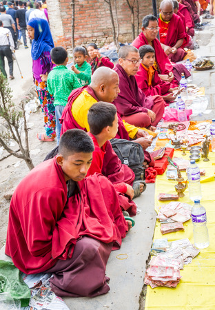 birthday religious: Kathmandu,Nepal - May 21,2016 : Monks are begging in Swayambhunath Stupa on Buddhas Birthday or Buddha Jayanti.