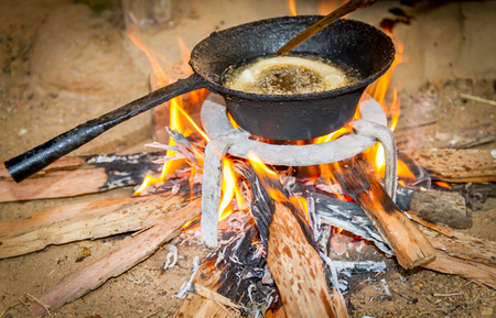 sel: Cooking Rice bread  on firewood traditionally in the rural village of Nepal. Stock Photo