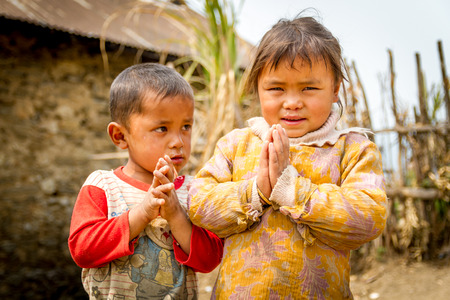 shyness: Chisapani,Nepal - March 26,2016 : Happy smiling children of rural village of Nepal are welcoming tourists with shyness on their faces. Editorial