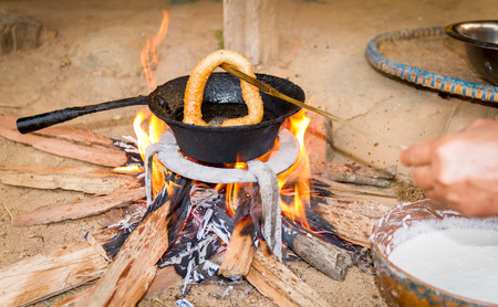 nepali: cooking Sel Roti or Nepali style bread for the wedding ceremony in the Nepali Village.