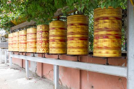 tibetian: Panning shot of Prayer Wheels in the premises of Swayambhunath Stupa,Nepal.