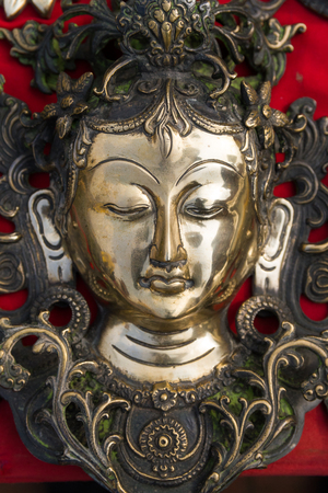 kept: Nepalese sculpture of Buddha kept for sale in the street of Kathmandu,Nepal. Stock Photo