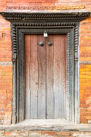 vintage look: Old and artistic wooden door of Nepal with the unique  vintage look.