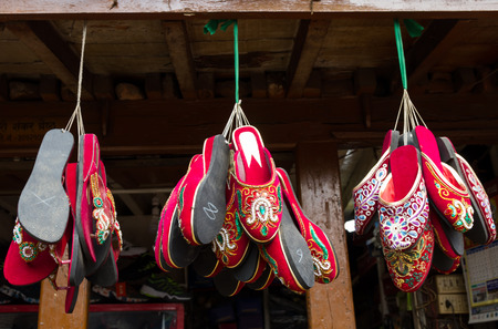 sandles: Red Sandles are hanging in the shop of Nepal for sale.