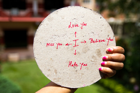 A hand holding a placard with the written sign of  love related Sentences. Stock Photo