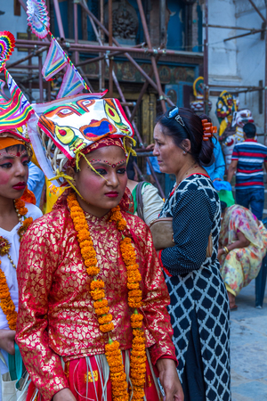 Kathmandu,Nepal - August 8,2017:Gai Jatra is a carnival of dancing, singing, mirth and laughter. The festival of cow is celebrated mainly in the Kathmandu Valley to commemorate the death of loved ones.  As part of the festival family members of the deceas