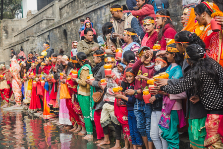 Kathmandu,Nepal - Feb 12,2018: Hindu devotees with bare foot and holy water pots offering Holy Water to Lord Shiva. This is on the occasion of Bol Bom and Mahashivaratri Festival at Pashupatinath Temple,Aryaghat. Stock Photo - 100388239