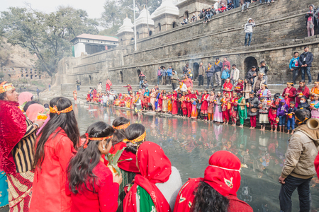 Kathmandu,Nepal - Feb 12,2018: Hindu devotees with bare foot and holy water pots offering Holy Water to Lord Shiva. This is on the occasion of Bol Bom and Mahashivaratri Festival at Pashupatinath Temple,Aryaghat. Stock Photo - 100388242